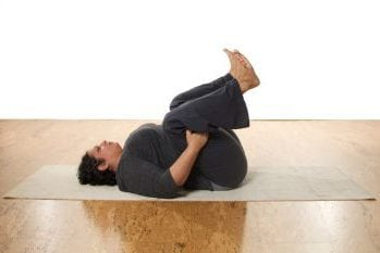 Apanasana (Knees to Chest) - seated or lying down for nurse with compassion fatigue.